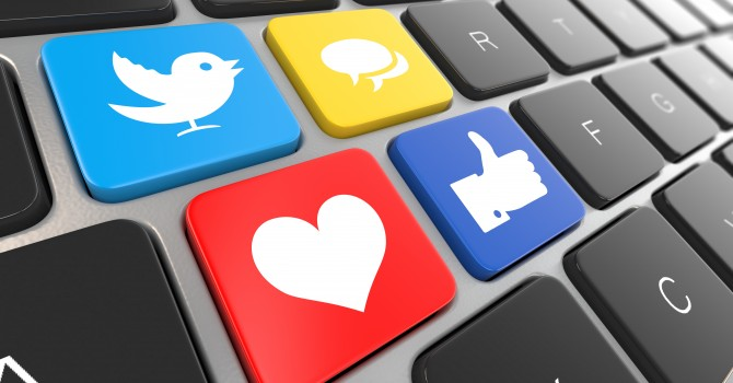 Social media, facebook and twitter, on laptop keyboard. Conceptual image. 3d