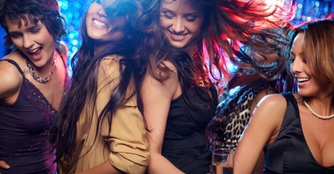 Young women having fun dancing at nightclubs